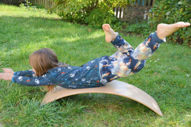 Yoga auf einem Balance Board