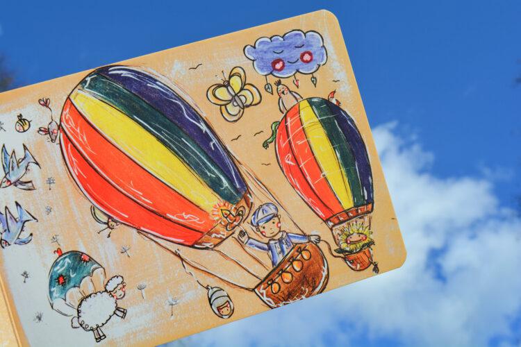 Junge und Blume im Heißluftballon